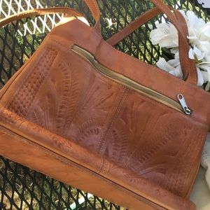 Handrooled leather shoulder bag made in Paraguay